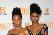 """Actors Anika Noni Rose (L) and Emayatzy Corinealdi attend the premiere screening of """"Night One"""" of the four night epic event series, """"Roots,"""" hosted by HISTORY at Alice Tully Hall on May 23, 2016 in New York City."""