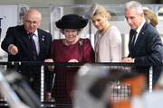 Queen Beatrix of the Netherlands (2ndL), Princess Maxima (2ndR), Saxony's Prime Minister Stanislaw Tillich (R) and CEO of Solarwatt Frank Schneider (L) attend a guided tour of a company for solar modules named Solarwatt on April 14, 2011 in Dresden, Germany. The Dutch royals are on a four-day visit to Germany that includes stops in Berlin, Dresden and Duesseldorf.
