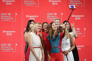 Michelle Wie (C) takes a selfie with Jessica Korda, Inbee Park, Suzann Pettersen, Lydia Ko, Paula Creamer, Chella Choi and Anna Nordqvist during the launch event at the Fairmont Hotel prior to the start of the HSBC Women's Championson March 3, 2015 in Singapore, Singapore.