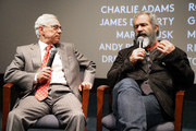 """Director Mel Gibson (R) talks with Medal of Honor recipient Col. Jack Jacobs at a  Q&A panel discussion at the """"Hacksaw Ridge"""" DC Screening at the Navy Memorial and Naval Heritage Center on October 28, 2016 in Washington, DC."""