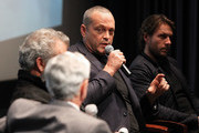 "Actor Vince Vaughn (C) and Actor Luke Bracey (R) participate in a Q&A panel discussion at the ""Hacksaw Ridge"" DC Screening at the Navy Memorial and Naval Heritage Center on October 28, 2016 in Washington, DC."