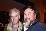 Chinese artist Ai Weiwei (R) and cameraman Christopher Doyle attend the 'Hail, Caesar!' premiere during the 66th Berlinale International Film Festival Berlin at Berlinale Palace on February 11, 2016 in Berlin, Germany.