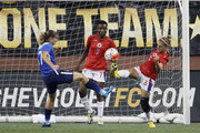 Kimberly Boulos #6 of Haiti kicks the ball away from the goal against Tobin Heath #17 of the United States as goalie Roselord Borgella #7 of Haiti looks on during the first half of the U.S. Women's 2015 World Cup victory tour match at Ford Field on September 17, 2015, in Detroit, Michigan.