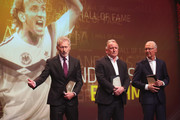 Paul Breitner, Andreas Brehme, Franz Beckenbauer on stage during the Hall Of Fame gala at Deutsches Fussballmuseum on April 01, 2019 in Dortmund, Germany.