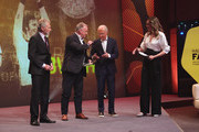 Paul Breitner, Andreas Brehme, Franz Beckenbauer and Juli Scharf on stage during the Hall Of Fame gala at Deutsches Fussballmuseum on April 01, 2019 in Dortmund, Germany.
