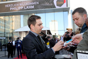 Philipp Lahm writes autographs as he arrives for the Hall Of Fame gala at Deutsches Fussballmuseum on April 01, 2019 in Dortmund, Germany.