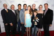 "(L-R) President and CEO of Crown Media Holdings Bill Abbott, President of Hallmark Hall of Fame Brad Moore, Actor Brian Tee, Actor Carlos Gomez, Actress Ali Skovbye, Actor Griffin Kane, Director Jay Russell, Actress Anne Heche and Executive Producer Brent Sheilds arrive at Hallmark Hall of Fame's ""One Christmas Eve"" Premiere Event at Fig & Olive Melrose Place on November 18, 2014 in West Hollywood, California."