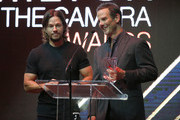 Actor Mark Wahlberg (L) and director Peter Berg speak osntage during the Hamilton Behind The Camera Awards presented by Los Angeles Confidential Magazine at Exchange LA on November 6, 2016 in Los Angeles, California.