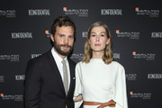 Jamie Dornan (L) and Rosamund Pike attend the Hamilton Behind the Camera Awards presented by Los Angeles Confidential Magazine on November 4, 2018 in Los Angeles, California.