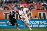 Joe Walters #1 of the Hamilton Nationals is covered by Will Mangan #21 of the Denver Outlaws during a Major League Lacrosse game at Sports Authority Field at Mile High on June 8, 2013 in Denver, Colorado. The Outlaws beat the Nationals 22-9.