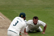 Sean Ervine of Hampshire stops a ball from Ali Brown of Nottinghamshire during the LV County Championship match between Hampshire and Nottinghamshire at the Rosebowl on May 5, 2010 in Southampton, England.