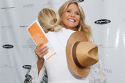 (L-R) Christie Brinkley and Kelly Rutherford attend Hamptons Magazine Celebration of The Children's Justice Campaign Of Joan & George Hornig on August 16, 2014 in Water Mill, New York.