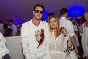 Andrew Warren and Petra Halloran attend Hamptons Magazine Chic at the Beach with John Legend on July 13, 2019 in Montauk, New York.