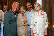 Geoffrey Zakarian, Katie Couric, John Molner and Martha Stewart attend the Hamptons Magazine Sunday Supper Celebrating The Launch Of Hamptons Entertaining: A Collection Of Summer Recipes From Geoffrey Zakarian & Friends Presented By Chateau D'Esclans And Christofle at Topping Rose House on August 25, 2019 in Bridgehampton, New York.