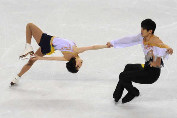 ISU World Figure Skating Championships - Day One [day one,figure skating,ice dancing,ice skating,figure skate,skating,sports,recreation,ice rink,dancer,jumping,dan zhang,hao zhang,short program,china,italy,turin,pairs,isu world figure skating championships]