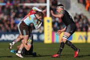 Charlie Walker of Harlequins is tackled by Chris Harris of Newcastle Falcons during the Aviva Premiership match between Harlequins and Newcastle Falcons at Twickenham Stoop on February 24, 2018 in London, England.