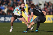 Charlie Walker of Harlequins takes on Chris Harris of Newcastle Falcons during the Aviva Premiership match between Harlequins and Newcastle Falcons at Twickenham Stoop on February 24, 2018 in London, England.
