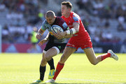 Mike Brown of Harlequins and Sam James of Sale Sharks during the Gallagher Premiership Rugby match between Harlequins and Sale Sharks at Twickenham Stoop on September 1, 2018 in London, United Kingdom.