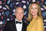 (EDITORIAL USE ONLY) Tommy Hilfiger and Dee Ocleppo Hilfiger attend the Harper's Bazaar Exhibition as part of the Paris Fashion Week Womenswear Fall/Winter 2020/2021 At Musee Des Arts Decoratifs on February 26, 2020 in Paris, France.