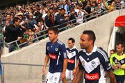 Harry Kewell and Archie Thompson of the Victory walk out for a Melbourne Victory A-League training session at AAMI Park on September 17, 2011 in Melbourne, Australia.