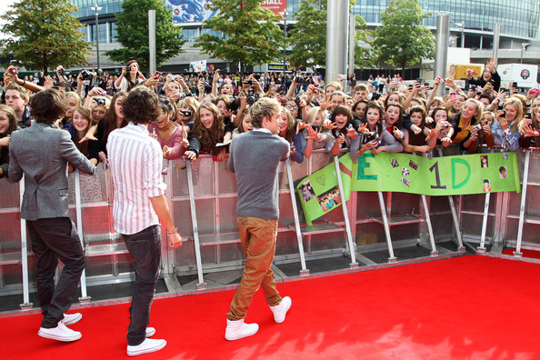Harry Styles (UK TABLOID NEWSPAPERS OUT) Harry Styles, Louis Tomlinson and Niall Horan of One Direction attend the BBC Teen Awards at Wembley arena on October 9, 2011 in London, United Kingdom.