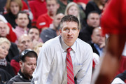 Head coach John Gallagher of the Hartford Hawks looks on against the Louisville Cardinals during the game at KFC Yum! Center on November 19, 2013 in Louisville, Kentucky. Louisville won 87-48.