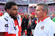 Braxton Miller #1 of the Ohio State Buckeyes talks with Head Coach Urban Meyer of the Ohio State Buckeyes after their game against the Hawaii Rainbow Warriors at Ohio Stadium on September 12, 2015 in Columbus, Ohio. Ohio State defeated Hawaii 38-0.