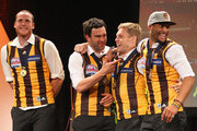Jarryd Roughead, Jordan Lewis, Sam Mitchell and Josh Gibson of the Hawks celebrate on stage during the Hawthorn Hawks AFL Grand Final post match function at Crown Palladium on September 28, 2013 in Melbourne, Australia.