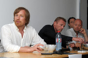 """(L-R) Director Morten Tyldum, author Jo Nesbo and actor Aksel Hennie speak at the """"Headhunters"""" photocall during the 64th Annual Cannes Film Festival at Majestic Hotel on May 14, 2011 in Cannes, France."""