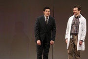 """Actors Jason Biggs and Bryce Pinkham take a bow at the curtain call for """"The Heidi Chronicles"""" Broadway Opening Night at The Music Box Theatre on March 19, 2015 in New York City."""