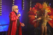 "German singer Heino performs on stage during the first BonnLive drive-in concert at Am Westwerk during the Coronavirus crisis on May 15, 2020 in Bonn, Germany. The project ""BonnLive Autokonzerte"" is a series of drive-in concerts with musicians of different genres. The area provides space for about 200 cars. Drive-ins are becoming an increasingly popular venue for singers, theater groups, and even churches to hold events while adhering to Coronavirus lockdown measures. Two peoples are allowed to attend per vehicle and the attendees must remain in their cars."