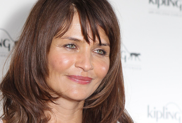 Photo of Helena Christensen and her 2018 clean make up style, products & tips
