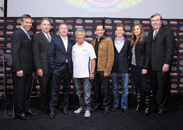 Izod IndyCar Series Event To Celebrate The 100th Anniversary Indianapolis 500 [social group,event,team,white-collar worker,izod indycar series,indianapolis 500,l-r,party,indycar,ceo,randy bernard,mario andretti,jeff belskus,helio castroneves]