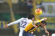 Jeros Pisano (R) of Hellas Verona battles for an aerial ball with Giuseppe Rossi of ACF Fiorentina during the Serie A match between Hellas Verona FC and ACF Fiorentina at Stadio Marc'Antonio Bentegodi on October 28, 2015 in Verona, Italy.