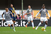 Luca Toni (2nd L)  of Hellas Verona Arturo Vidal (1th L), Leonardo Bonucci (2nd R) and Paul Pogba (1th R) of Juventus  during the Serie A match between Hellas Verona FC and Juventus at Stadio Marc'Antonio Bentegodi on February 9, 2014 in Verona, Italy.