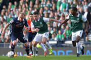 Liam Boyce of Ross County is tackled by Darren McGregor and Marvin Bartley of Hibernian during the Scottish League Cup Final between Hibernian FC and Ross County FC at Hampden Park on March 13, 2016 in Glasgow, Scotland.