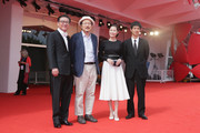 (L-R) Actor Kim Euisung, director Hong Sangsoo, actors Moon Sori and Ryo Kase attend the 'Hill Of Freedom' - Premiere during the 71st Venice Film Festival on September 2, 2014 in Venice, Italy.