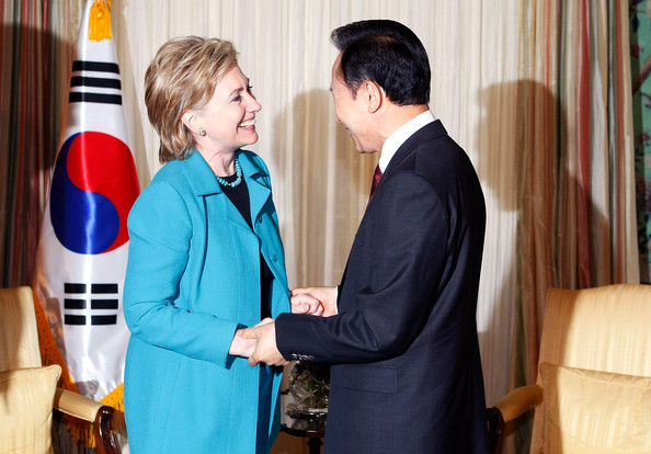 U.S. Secretary of State Hillary Rodham Clinton (L) is greeted by South Korean President Lee Myung-Bak (R) during their meeting at the Blair House June 15, 2009 in Washington, DC. Lee is on a three-day visit in Washington and will meet with President Barack Obama on June 16 to discuss diplomatic relations between the two countries.