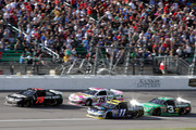 Martin Truex Jr., driver of the #78 Furniture Row Chevrolet, races Denny Hamlin, driver of the #11 FedEx Office Toyota, Clint Bowyer, driver of the #15 Pink Lemonade 5-hour ENERGY Benefitting LBBC Toyota, and Austin Dillon, driver of the #3 American Ethanol Chevrolet, during the NASCAR Sprint Cup Series Hollywood Casino 400 at Kansas Speedway on October 5, 2014 in Kansas City, Kansas.