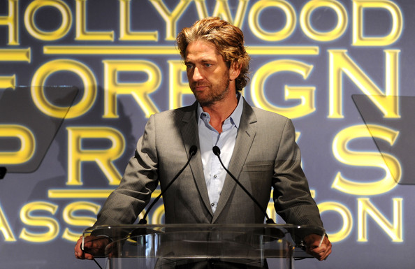 Actor Gerard Butler speaks onstage during the Presentation of Grants at the Hollywood Foreign Press Association's 2011 Installation Luncheon at Beverly Hills Hotel on August 4, 2011 in Beverly Hills, California.
