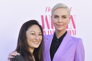 Charlize Theron (R) and Beth Kono attend The Hollywood Reporter's Annual Women in Entertainment Breakfast Gala at Milk Studios on December 11, 2019 in Hollywood, California.