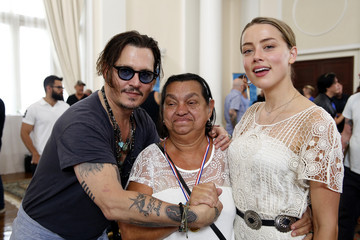 Johnny Depp and Wife Amber Heard Get Emotional as They Help Brazilians Hear for the First Time