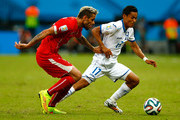 Valon Behrami of Switzerland and Andy Najar of Honduras compete for the ball during the 2014 FIFA World Cup Brazil Group E match between Honduras and Switzerland at Arena Amazonia on June 25, 2014 in Manaus, Brazil.