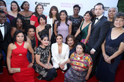 Rashida Jones and Eva Longoria (C) with domestic workers attend National Domestic Workers Alliance's awards night watch party at The Jane Club on February 24, 2019 in Los Angeles, California.