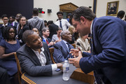 Writer Ta-Nehisi Coates shakes hands with House Subcommittee Ranking Member Mike Johnson (R-LA) following a House Judiciary Subcommittee hearing on slavery reparations on June 19, 2019 in Washington, DC. The subcommittee debated the H.R. 40 bill, which proposes a commission be formed to study and develop reparation proposals for African-Americans.