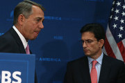 House Speaker John Boehner (R-OH) (L) stands with House Majority Leader Eric Cantor (R-VA) (R) during a news conference at the U.S. Capitol June 10, 2014 in Washington, DC. Speaker Boehner and Leader Cantor spoke to the media after attending a closed meeting with House Republicans. In an unexpected upset, Cantor was later defeated by Tea Party challenger David Brat in Virginia's congressional primary.