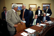 House Rules Committee chairman Rep. Pete Sessions (3rd L) (R-TX) confers with fellow committee members Rep. Rob Bishop (2nd L) (R-UT), Rep. Richard Nugent (4th R) (R-FL) and Rep. Daniel Webster (2nd R) (R-FL) prior to the start of a committee meeting July 29, 2014 at the U.S. Capitol in Washington, DC. The committee met to formulate a rule on providing the authority to begin litigation for actions by the President or other executive branch officials inconsistent with their duties under the Constitution of the United States.