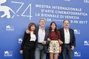 """From left : actress Ariane Ascaride, French director Robert Guediguian, actress Anais Demoustier and actor Jean-Pierre Darroussin attend the photocall of the movie """"La Villa"""" (The House by the sea) presented in competition at the 74th Venice Film Festival on September 3, 2017 at Venice Lido.  / AFP PHOTO / Tiziana FABI"""