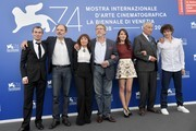 """From left : actor Robinson Stevenin, actor Jean-Pierre Darroussin, actress Ariane Ascaride, French director Robert Guediguian, actress Anais Demoustier, actor Jacques Boudet and actor Yann Tregouet attend the photocall of the movie """"La Villa"""" (The House by the sea) presented in competition at the 74th Venice Film Festival on September 3, 2017 at Venice Lido.  / AFP PHOTO / Tiziana FABI"""