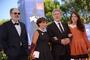 """From left : actor Jean-Pierre Darroussin, actress Ariane Ascaride, French director Robert Guediguian and actress Anais Demoustier attend the premiere of the movie """"La Villa"""" (The House by the sea) presented in competition at the 74th Venice Film Festival on September 3, 2017 at Venice Lido.  / AFP PHOTO / Filippo MONTEFORTE"""